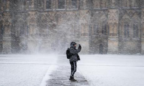 A man takes a selfie in front of Wells cathedral in Somerset. The south-west has been particularly badly affected by the weather chaos