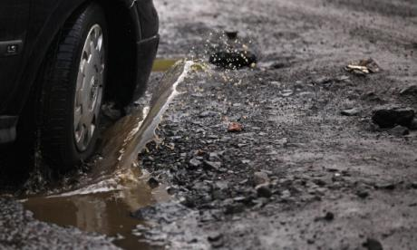 Cash-strapped local councils are using bureaucratic measures to avoid fixing potholes