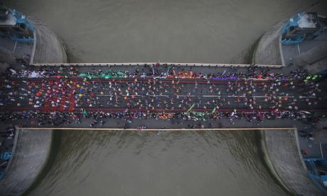 London Marathon runners cross Tower Bridge having completed twelve miles of the course