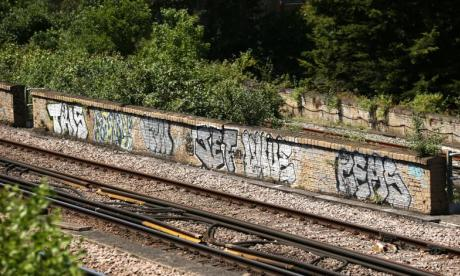 Graffiti tributes left at Loughborough Junction station for three men killed by train
