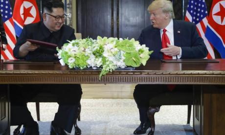 Donald Trump and Kim Jong-un sign unspecified document in Singapore