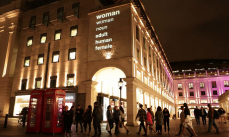 'Woman definition' campaigner projects dictionary definition of woman onto London buildings