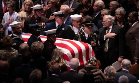 George HW Bush hailed the 'last great-soldier statesman' in eulogy