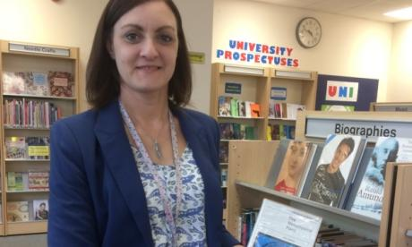 Rachel Gibson from Lowestoft Library with the book
